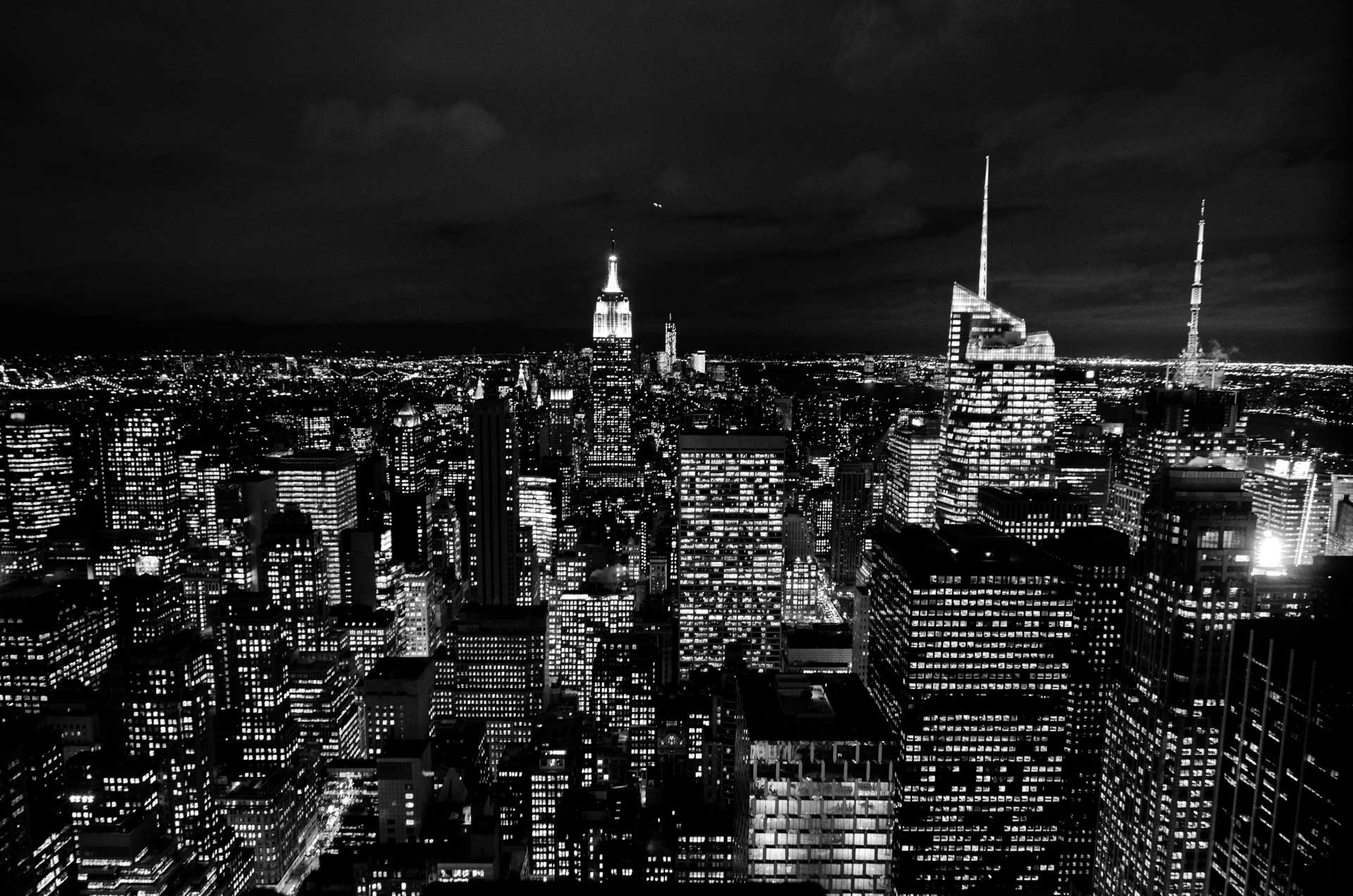 Black-and-white photo of skyscrapers in Manhattan at night